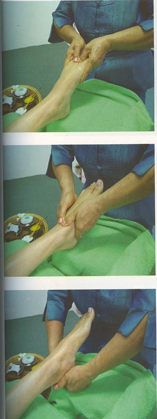 Cardiff Reflexology photo - foot reflexology with Thai style stick using herbs