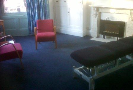 massage therapy room at quaker meeting house - luxurious room with fire place and bay windows overlooking St David's Cathedral. Enjoy your treatment and relax with a cup of herbal tea